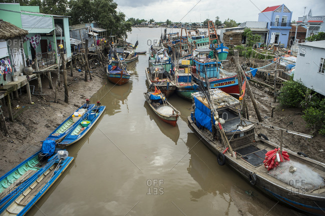 Fishing boats in a shallow canal in Vietnam