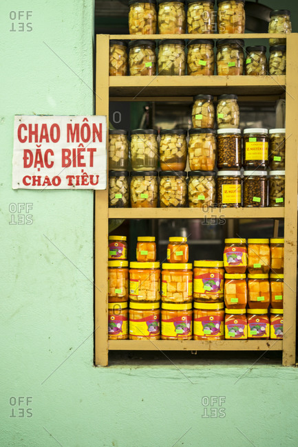 Pickled vegetables and fruits in jars at a store in Vietnam