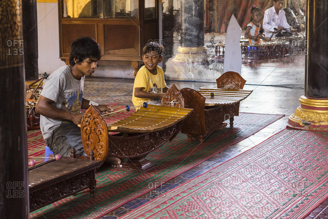 Sa Dec, Vietnam - June 27, 2013: Children playing t'rungs, traditional wooden xylophones
