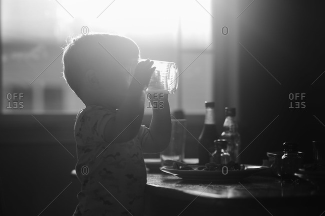 Young boy drinking from a glass