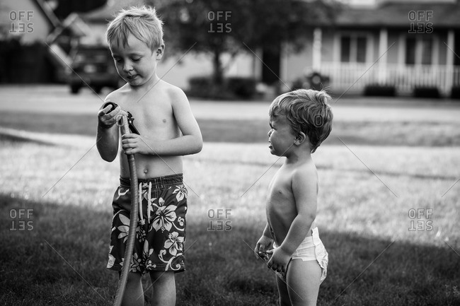 Children playing with a sprinkler