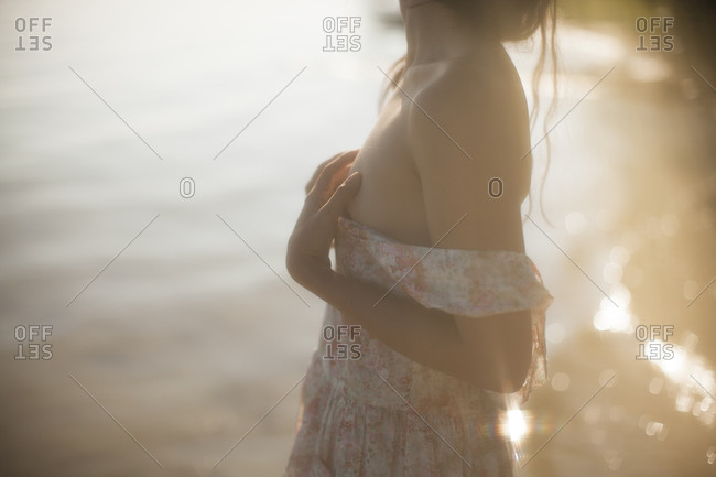 Close up of a girl kneeling by the lake side