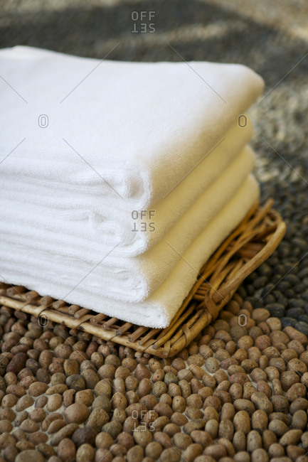 Stack of white towels in a spa setting