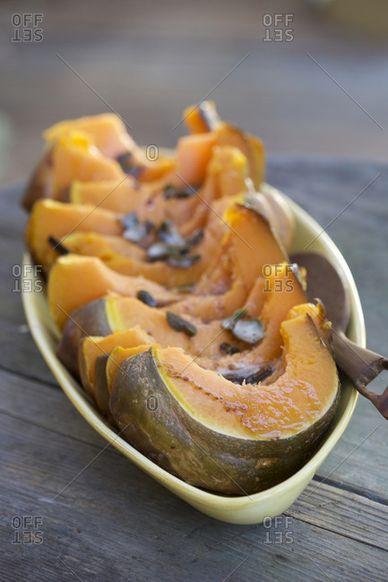 Roasted Squash outdoors on rustic wood table