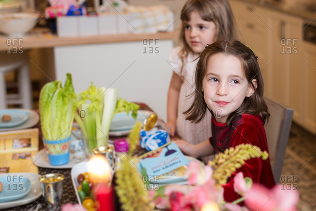 Children sitting by dining table