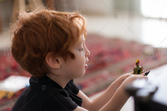 Redhead boy playing in living room