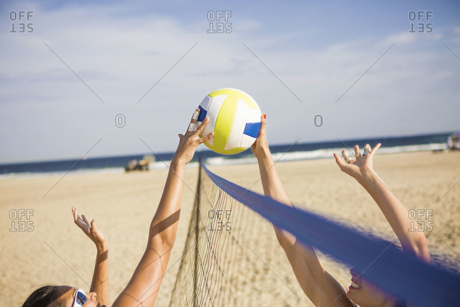 Close up of hitting the volleyball over the net