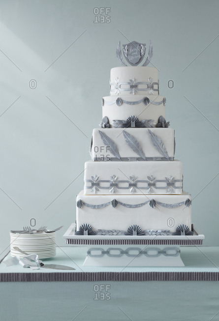 Tiered cake with paper garlands