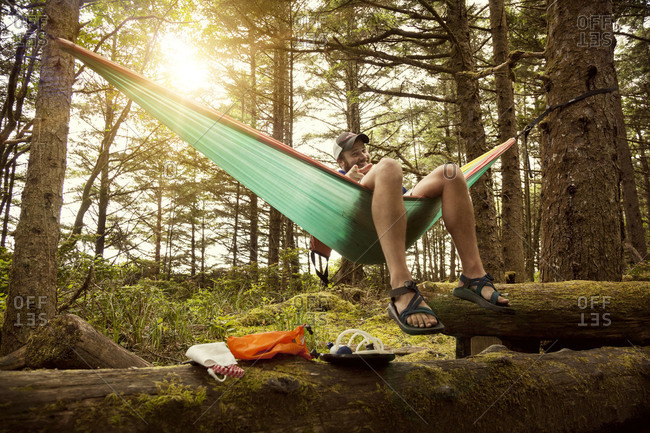 Man resting in hammock in the forest