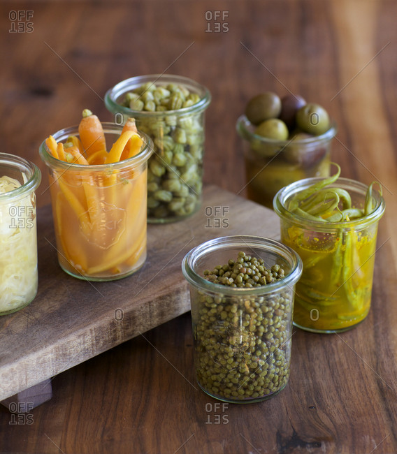 An assortment of pickles in glass jars