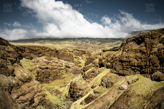 Clouds over a rocky landscape in Maui, Hawaii
