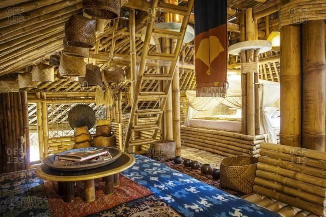 Ubud, Bali, Indonesia - February 6, 2014: Comfortable furnishings inside a cottage