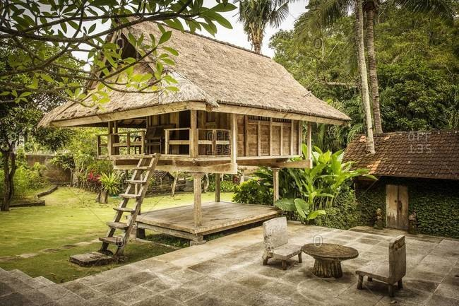 Ubud, Bali, Indonesia - January 31, 2014: Elevated thatched roof cottage