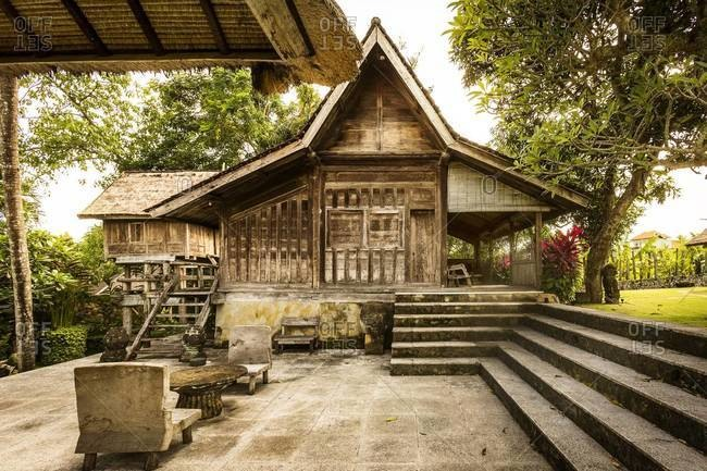 Ubud, Bali, Indonesia - February 1, 2014: Traditional wooden cottages in tropical gardens