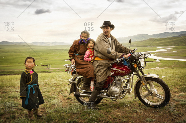 Mongolia - July 17, 2013: Mongolian family traveling by a motorcycle