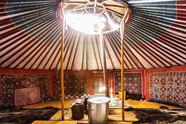 Mongolia - July 23, 2013: Exotic luxury yurt accommodation furnished in carpets and furs