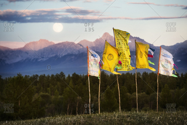 Prayer flags in Mongolia with full moon