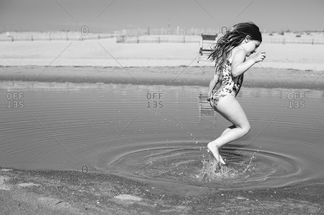 Young girl jumping on a beach