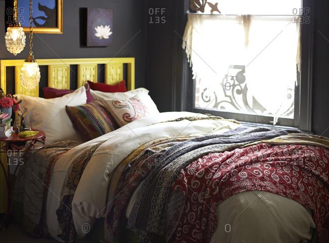 Bedroom interior with yellow headboard