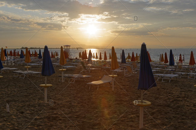 Beach with sun loungers in the evening, Udine, Italy