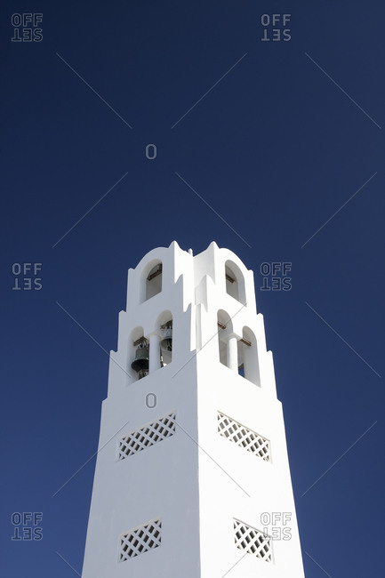 View to church tower in front of blue sky, Santorini, Greece