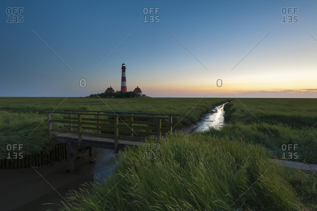 View of Westerheversand Lighthouse after sunset, Schleswig-Holstein, Germany