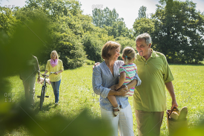 Three generations family walking on a meadow