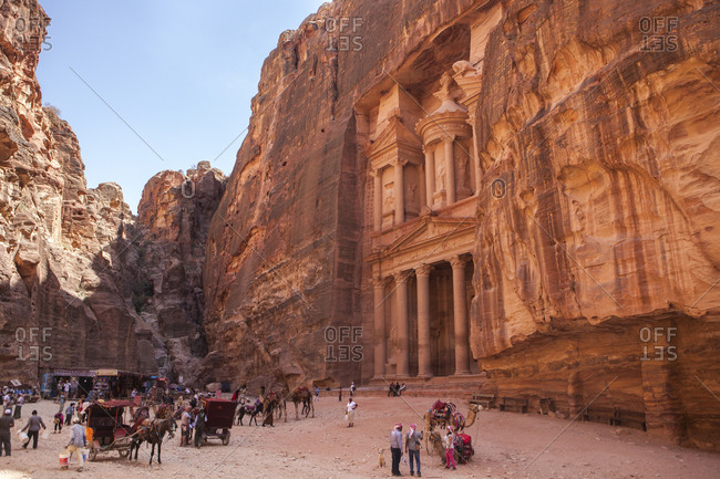 Tourists gather in front of the Treasury building in Petra, Jordan
