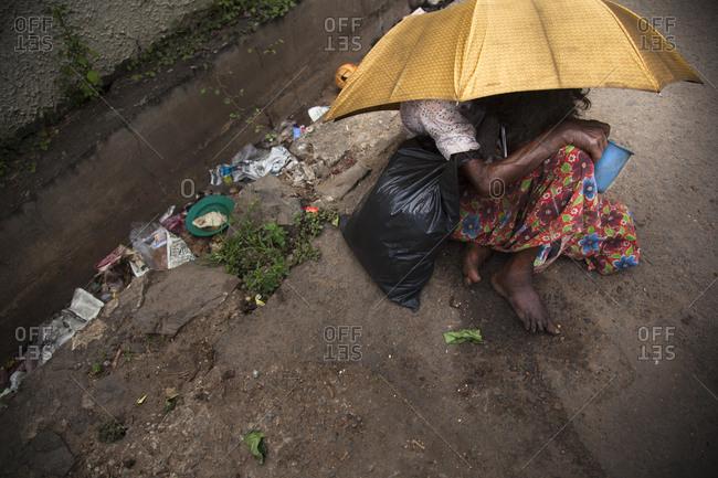 Homeless women begging on the streets of Panadura, Sri Lanka