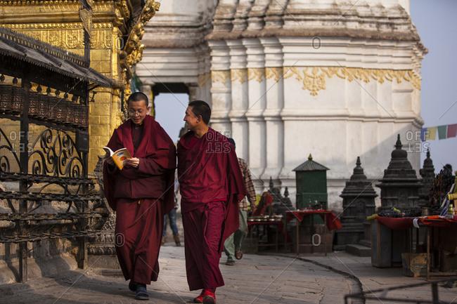 Kathmandu, Nepal - February 2, 2011: Young monks at the temple complex at Swayambhunath, Kathmandu, Nepal