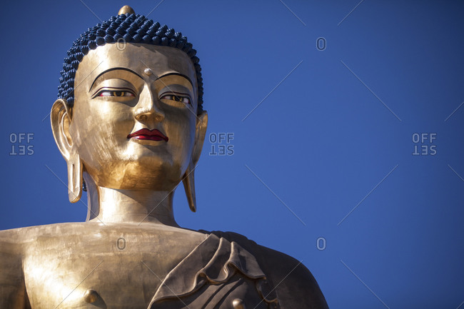Close up of the head of a Buddha statue in Thimphu, Bhutan