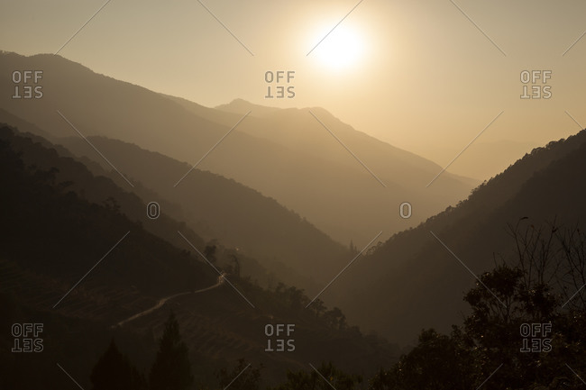 View of a valley at sunset in the Himalaya in central Bhutan