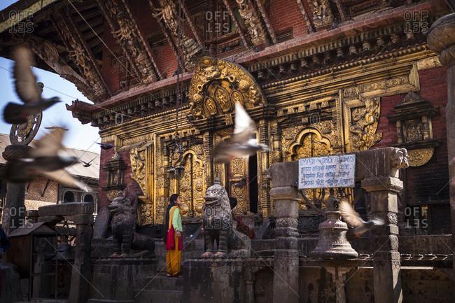 Changunarayan, Nepal - February 11, 2011: Woman standing at the Changu Narayan Temple, Nepal