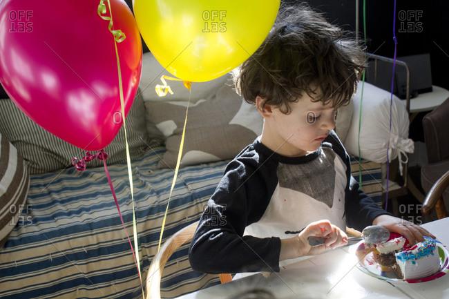 Birthday boy eating cake