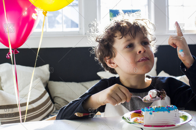 Boy enjoying his birthday cake