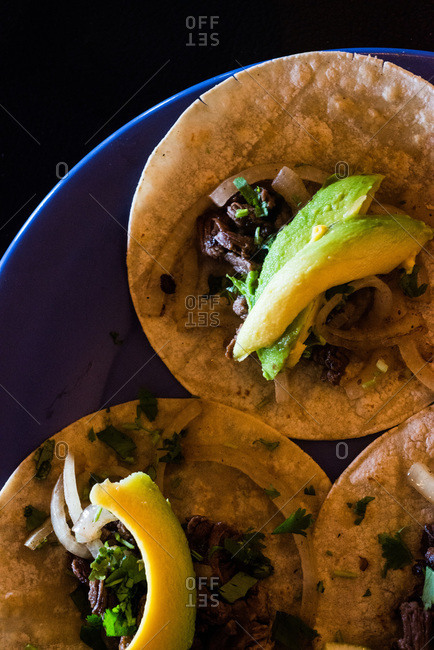 Close up of tacos with beef and avocado