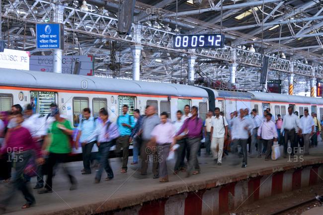 Commuters at the Chhatrapati Shivaji Terminus train station in Mumbai, India