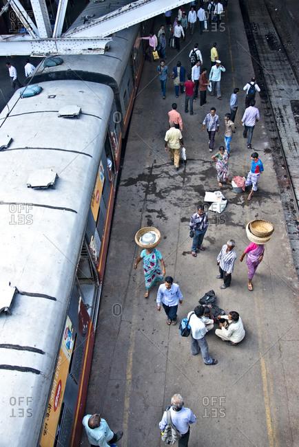Chhatrapati Shivaji Terminus train station, Mumbai, India - November 1, 2012: High angle view of people on a platform in Chhatrapati Shivaji Terminus train station, Mumbai, India