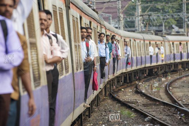 Chhatrapati Shivaji Terminus train station, Mumbai, India - November 1, 2012: Commuters arriving at the Chhatrapati Shivaji Terminus train station in Mumbai, India