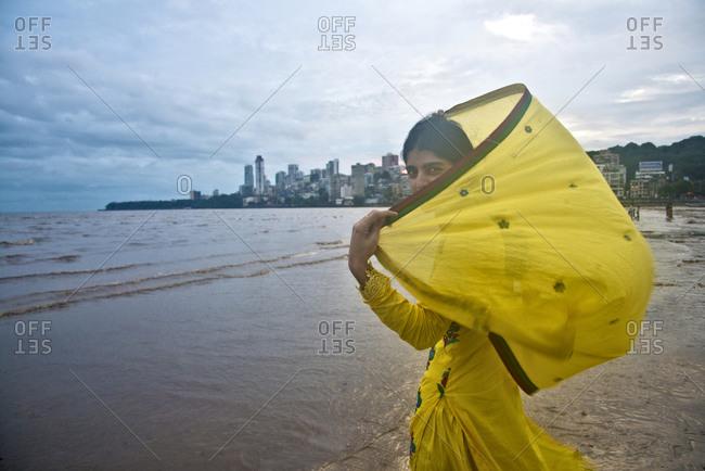 Mumbai, India - October 4, 2013: Woman on Chowpatty beach, Mumbai, India