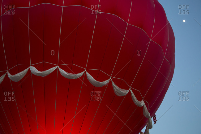 The envelope of a red hot air balloon