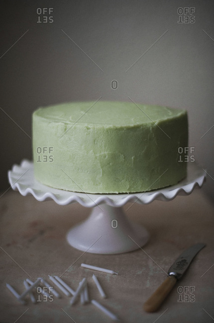 Birthday cake with green frosting