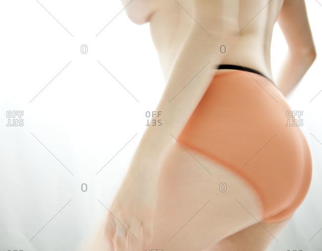Woman wearing an orange underwear