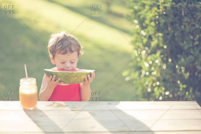 Young boy eating a watermelon