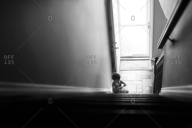 Young boy playing on a staircase