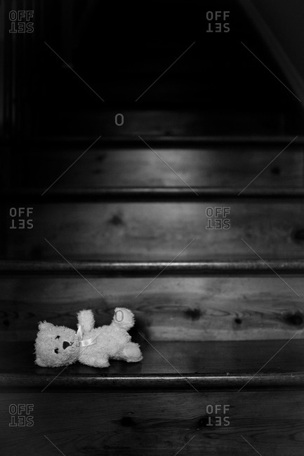 Stuffed toy bear left on a staircase