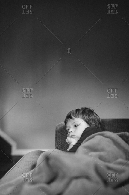 Young boy resting on a couch