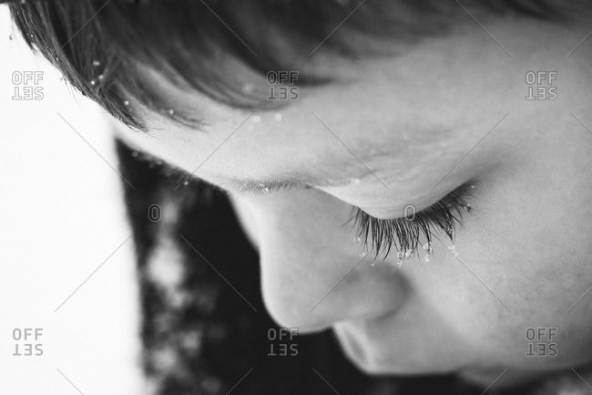 Portrait of a young boy with snowy eyelashes