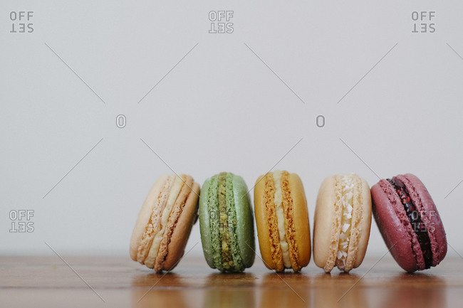 Close up of five colorful macarons