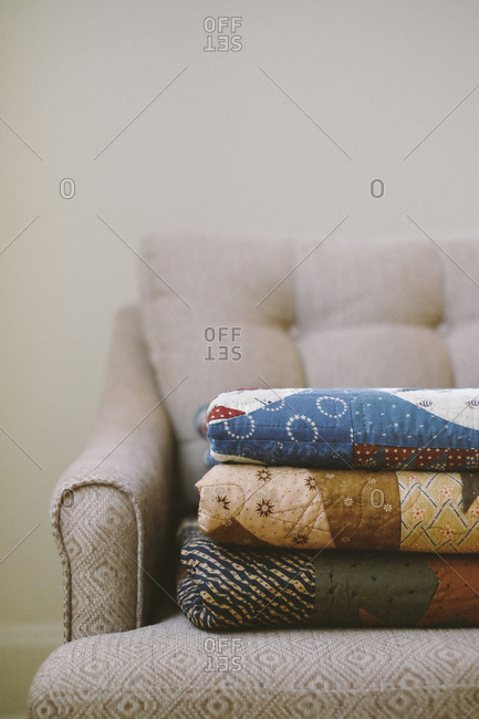 Close up of folded quilt blankets on a couch